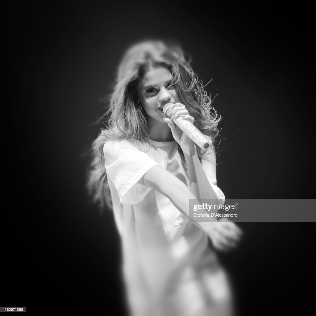 <a gi-track='captionPersonalityLinkClicked' href=/galleries/search?phrase=Selena+Gomez&family=editorial&specificpeople=4295969 ng-click='$event.stopPropagation()'>Selena Gomez</a> performs on stage at Alcatraz on September 16, 2013 in Milan, Italy.