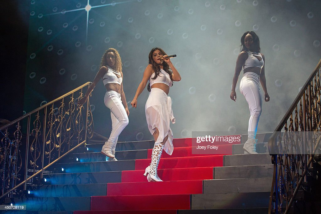 <a gi-track='captionPersonalityLinkClicked' href=/galleries/search?phrase=Selena+Gomez&family=editorial&specificpeople=4295969 ng-click='$event.stopPropagation()'>Selena Gomez</a> (C) performs onstage during her 'Stars Dance Tour' at Bankers Life Fieldhouse on November 19, 2013 in Indianapolis, Indiana.