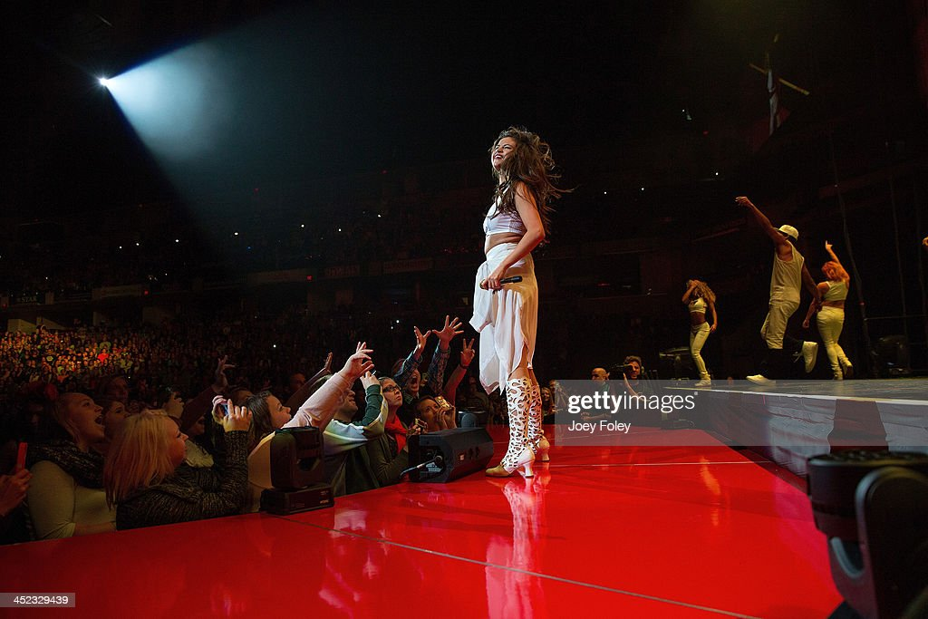 <a gi-track='captionPersonalityLinkClicked' href=/galleries/search?phrase=Selena+Gomez&family=editorial&specificpeople=4295969 ng-click='$event.stopPropagation()'>Selena Gomez</a> performs onstage during her 'Stars Dance Tour' at Bankers Life Fieldhouse on November 19, 2013 in Indianapolis, Indiana.