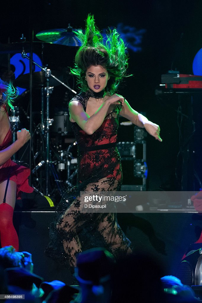 <a gi-track='captionPersonalityLinkClicked' href=/galleries/search?phrase=Selena+Gomez&family=editorial&specificpeople=4295969 ng-click='$event.stopPropagation()'>Selena Gomez</a> performs onstage during Z100's Jingle Ball 2013 at Madison Square Garden on December 13, 2013 in New York City.