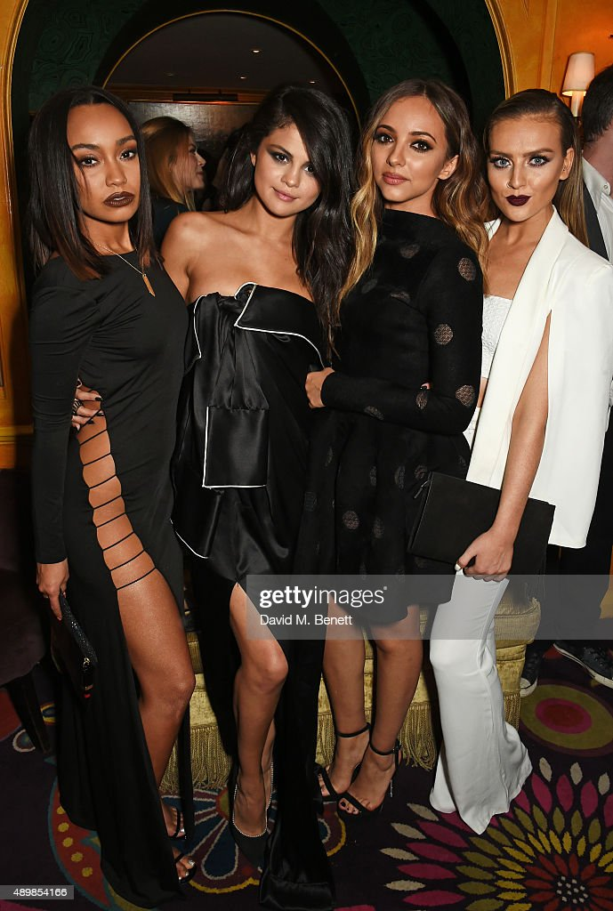 Selena Gomez poses with LeighAnne Pinnock Jade Thirlwall and Perrie Edwards of Little Mix attend Annabel's for an intimate dinner and exclusive...