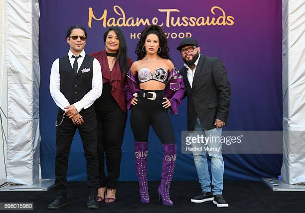 Selena's husband Chris Perez sister Suzette Quintanilla and brother AB Quintanilla onstage during Madame Tussauds Hollywood's unveiling of Singer...
