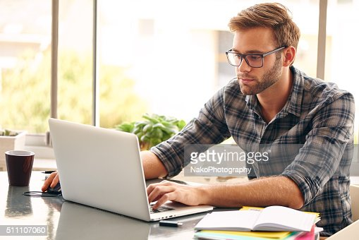 Self employed business person working from home : Stock Photo