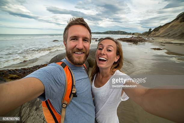 Self portrait of young couple at the Moeraki boulders-New Zealand