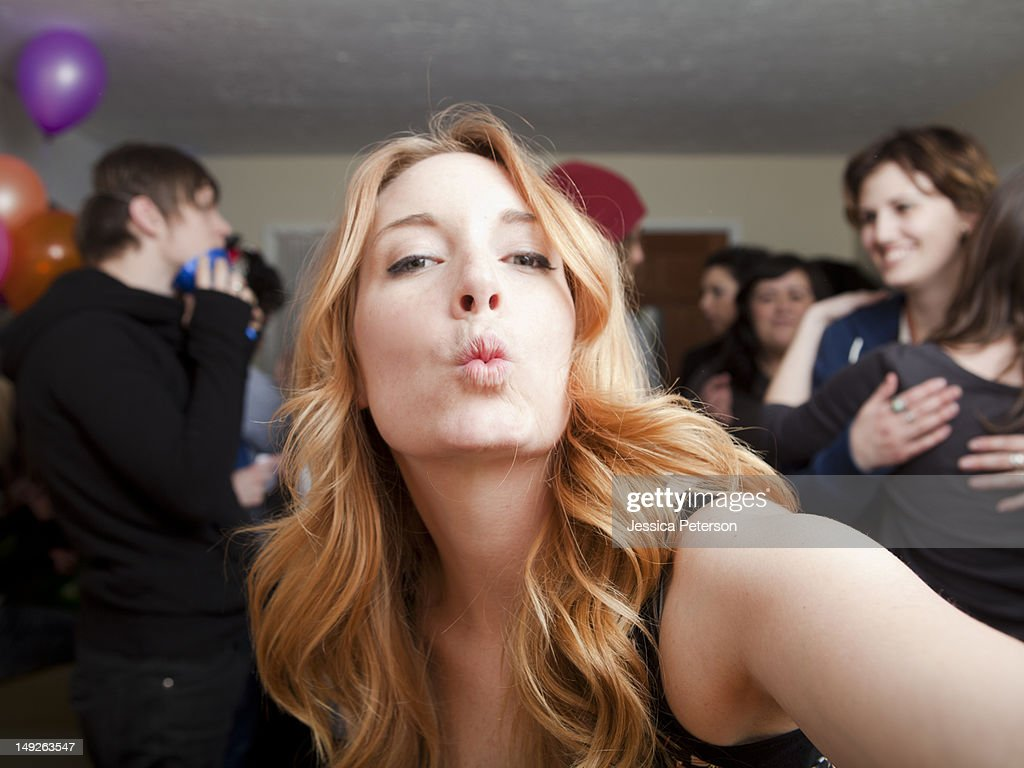 Self portrait of young woman at party