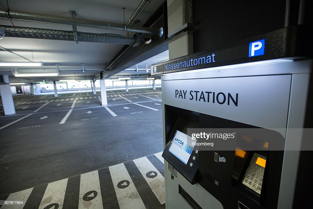 A self service ticket machine sits inside an empty automobile parking area at Berlin Brandenburg International Willy Brandt Airport in Schoenefeld, Germany, on Monday, May 3, 2016. The massively overbudget airport was planned to open in 2010 and handle 27 million passengers a year, crowning Berlin as the continent's 21st century crossroads. Photographer: Krisztian Bocsi/Bloomberg via Getty Images
