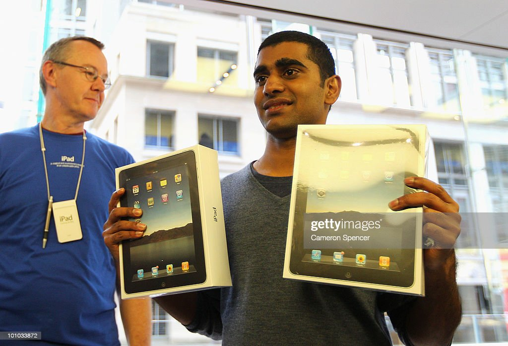 Self-confessed Apple fanatic Rahul Koduri puchases the first iPad in Australia at the Apple store on George Street on May 28, 2010 in Sydney, Australia. Apple's new tablet media device went on sale in nine countries around the world today following its launch in the United States in April this year.