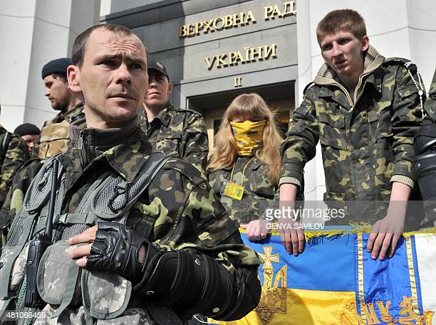 Selfdefence forces of Maydan stand guard in front of the Ukrainian Parliament while supporters of the right wing party Pravyi Sector stage protest in...