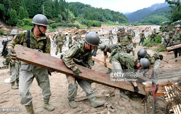 SelfDefense Forces members search for victims a week after the torrential deluge began on July 12 2017 in Asakura Fukuoka Japan Searchers meantime...
