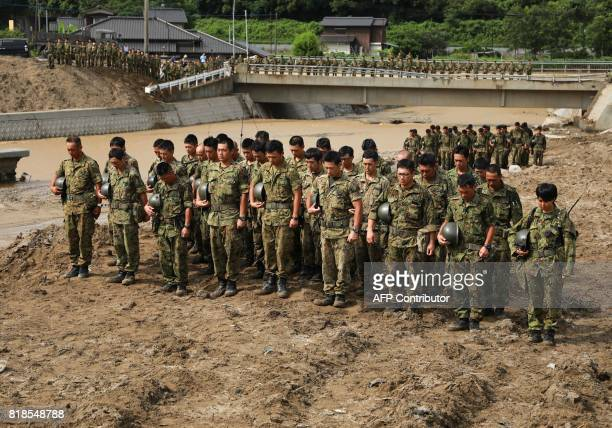 SelfDefense Forces solders keeps a minutes of silence for victims prior to their searching operation at a flooded area in Asakura city Fukuoka...