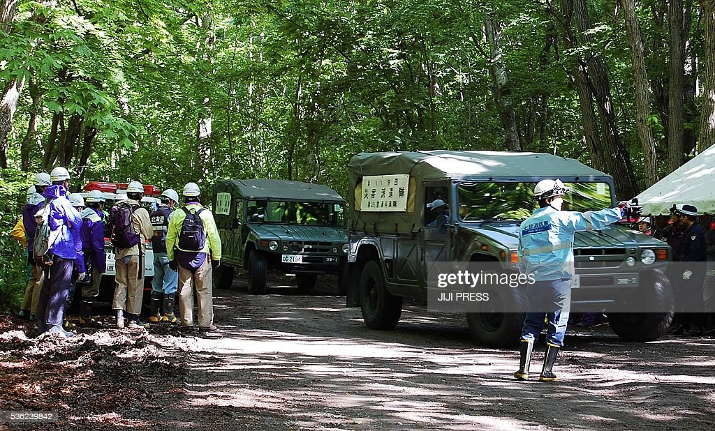 Self-Defense Forces vehicles are heading to search for a missing boy in Nanae on Japan's main northern island of Hokkaido, on June 1, 2016. Japan's military on June 1 joined the difficult search for a seven-year-old boy missing since his parents abandoned him in a bear-inhabited forest, officials said. / AFP / JIJI PRESS / JIJI PRESS / Japan OUT