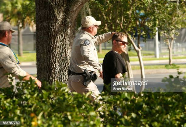 Selfdescribed white nationalist Colton Fears of Pasadena Texas is escorted by Florida Highway Patrol troopers as the troopers assist his departure...