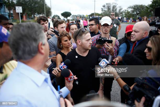 Selfdescribed white nationalist Colton Fears of Pasadena Texas speaks to members of the media as demonstrators gather near the site of a planned...