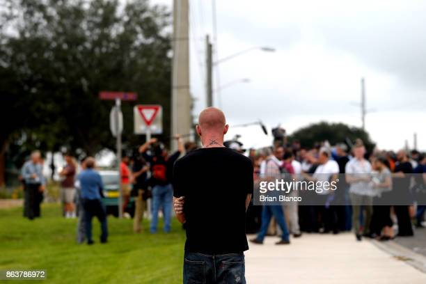 Selfdescribed white nationalist Tyler Tenbrink of Houston Texas center watches members of the media as demonstrators gather near the site of a...