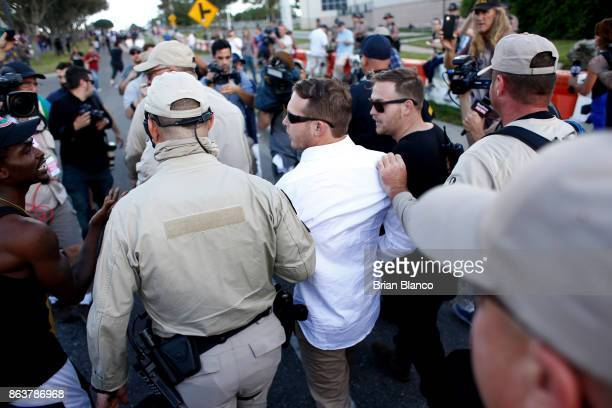 Selfdescribed white nationalists William Fears left and his brother Colton Fears both of Pasadena Texas walk inside a group of Florida Highway Patrol...