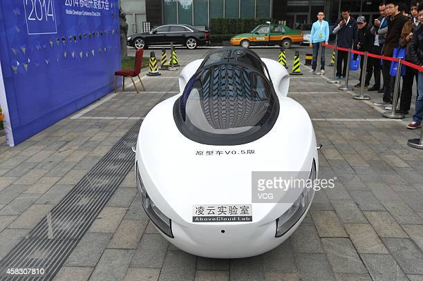 A selfdeveloped twowheeled selfbalancing electromobile prototype V05 exhibits at the Mobile Developer Conference China 2014 on November 1 2014 in...
