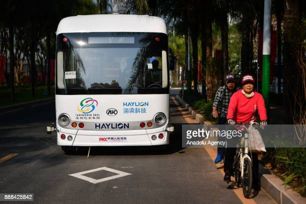 A selfdriving bus is seen on a road on December 8 2017 in Shenzhen China The buses have designed speed of 10 to 30 kph Equipped with lidar censors...