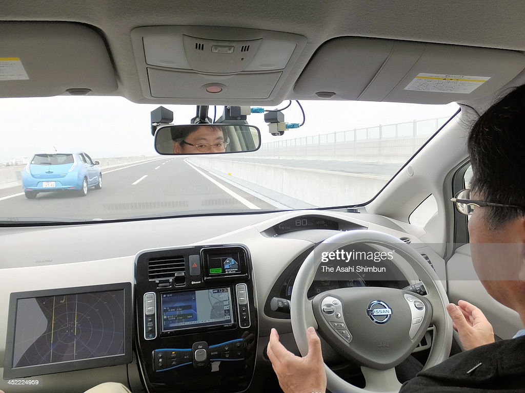 A self-driving Nissan Leaf makes an automatic lane change on the Sagami Expressway after the driver switched on a turn signal during a test run on November 25, 2013 in Kanagawa, Japan. In the latest testing on a 3.2-kilometer section of the Sagami Expressway, Nissan let a self-driving electric Leaf make its own independent decisions by using onboard sensors and cameras to detect the motions of other vehicles, as well as read road signs. According to Nissan officials, it was the first time that a self-driving vehicle that automatically operates its main controls, including steering and braking, has operated on an expressway in Japan.