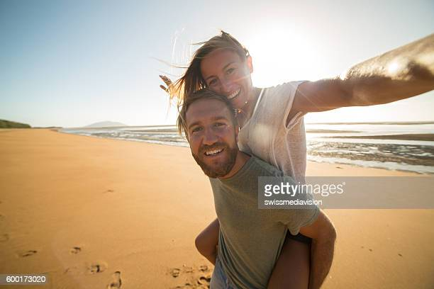 Selfie : Couple capturing fun moments on the beach