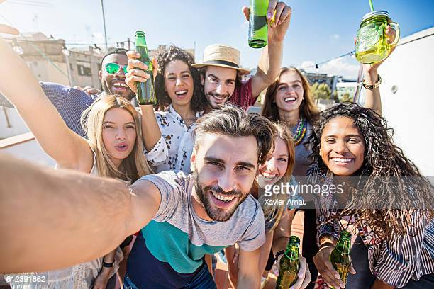 Selfie in a rooftop party