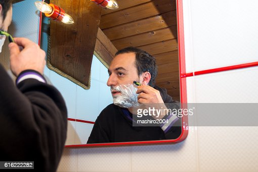 selfie in the mirror while i shave beard : Stock Photo