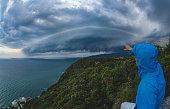Selfie taken in the storm with a beautiful shelf cloud approaching the land