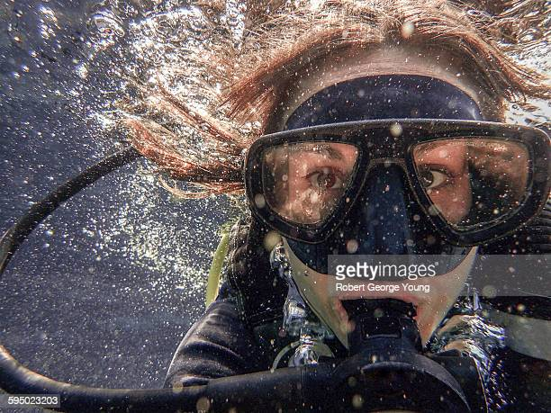 'Selfie' like photo of young woman scuba diving