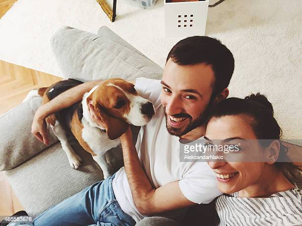 Selfie of a couple with a dog