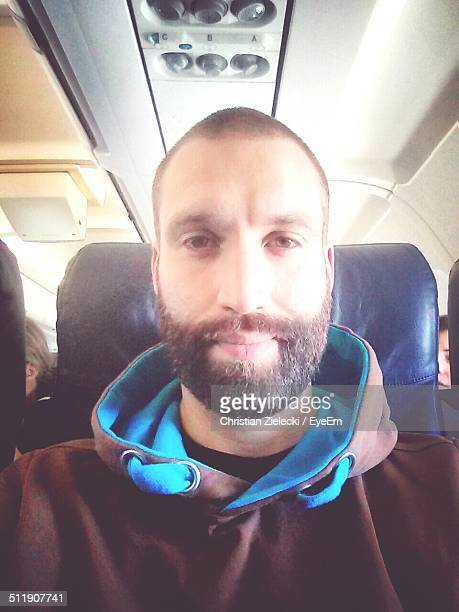 Selfie of bearded man in plane