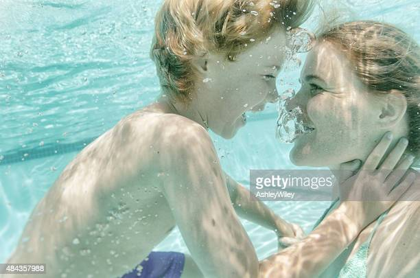 Selfie of boy and mom under water