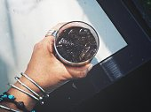 Selfie of cola with ice cubes on hand