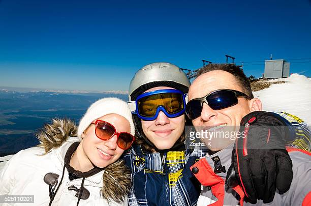Selfie of father, daughter and son on ski slope