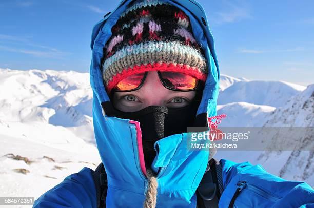 Selfie of female mountaineer on snowy mountain top