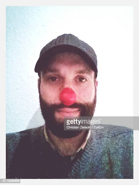 Selfie of man with clown's nose