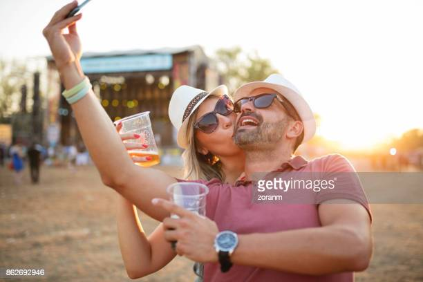Selfie of mid adult couple at festival