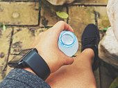 Selfie of smartwatch and sport shoes with water bottle