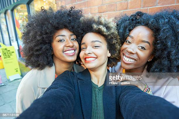 Selfie of three young friends.