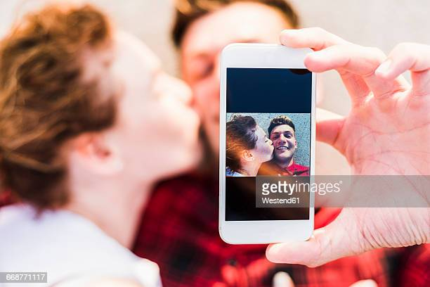 Selfie of young couple lying down