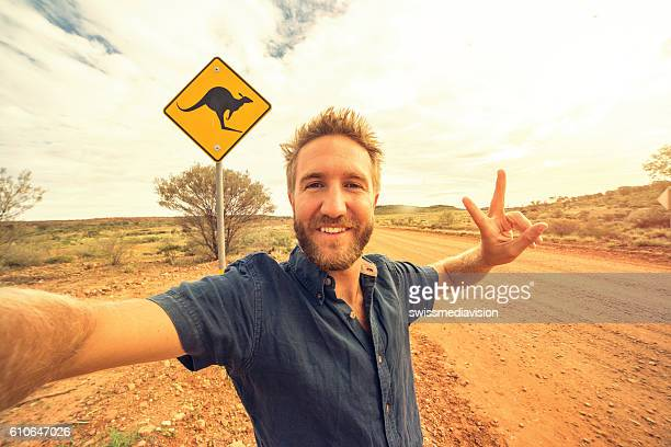Selfie of young man in Australia standing near kangaroo sign
