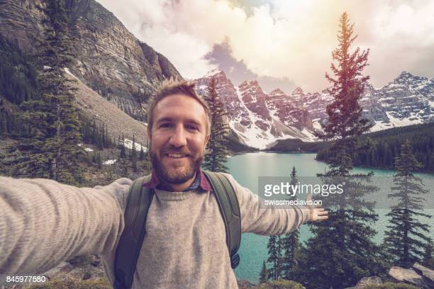 Selfie of young man on mountain trail