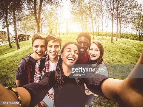 Selfie of young multiethnic friends in a park