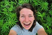 Selfie of young woman in marijuana field