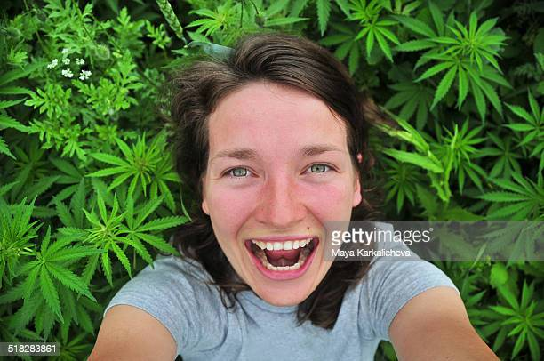 Selfie of young woman in marijuana field