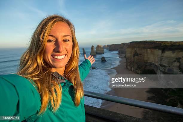 Selfie portrait at sunrise of woman at the Twelve Apostles