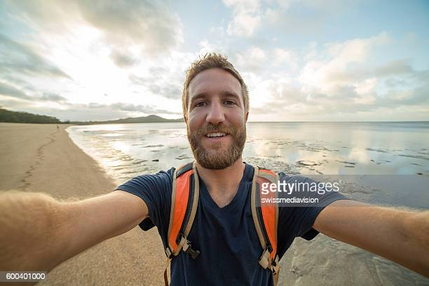 Selfie portrait of young man traveling the world