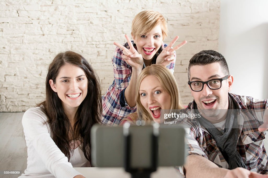 Selfie avec un bras télescopique pour smartphone : Photo