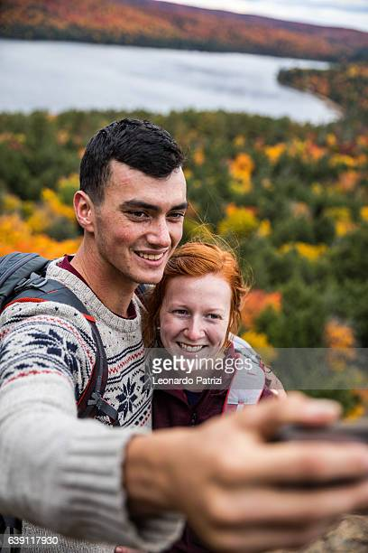 Selfie with a view on a mountain peak in Canada