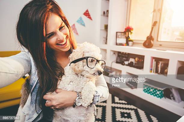 Selfie with cute little dog with eyeglasses