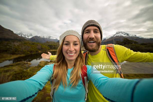 Selfie - Young couple hiking in autumn, New Zealand