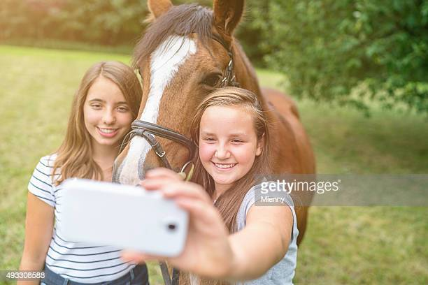 Selfies Girls with Mobile Phone shooting Self Portraits with Horse